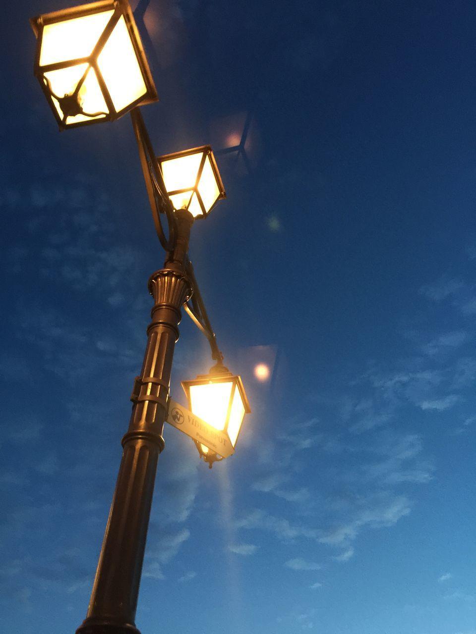 lighting equipment, illuminated, low angle view, street light, electric light, sky, street lamp, floodlight, no people, night, gas light, outdoors, blue, electricity