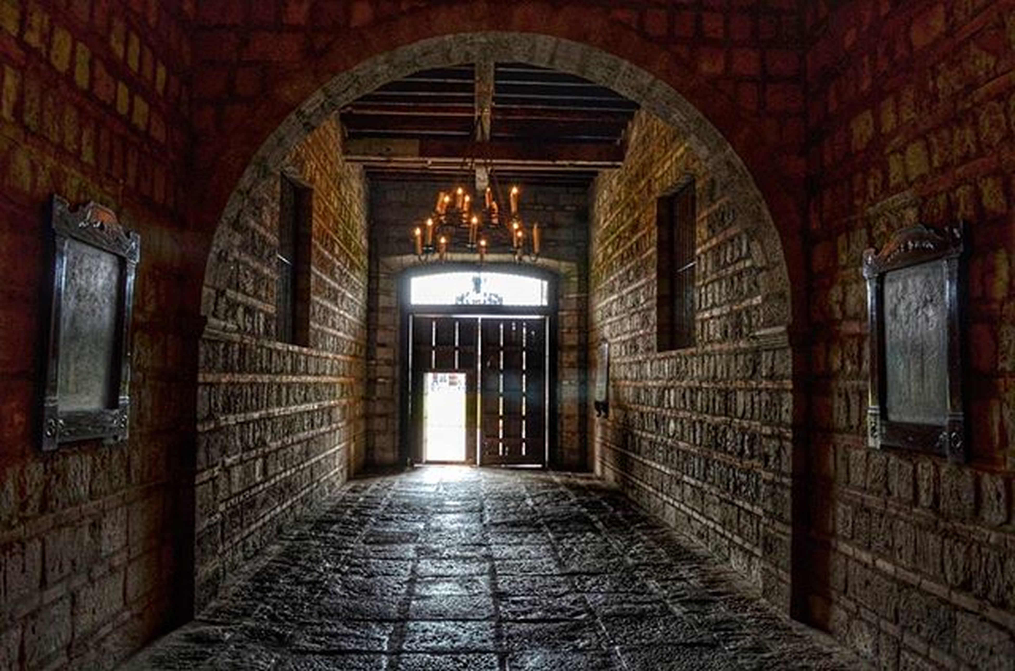 architecture, arch, built structure, the way forward, indoors, archway, corridor, building exterior, entrance, door, diminishing perspective, narrow, empty, building, cobblestone, old, illuminated, brick wall, history, no people