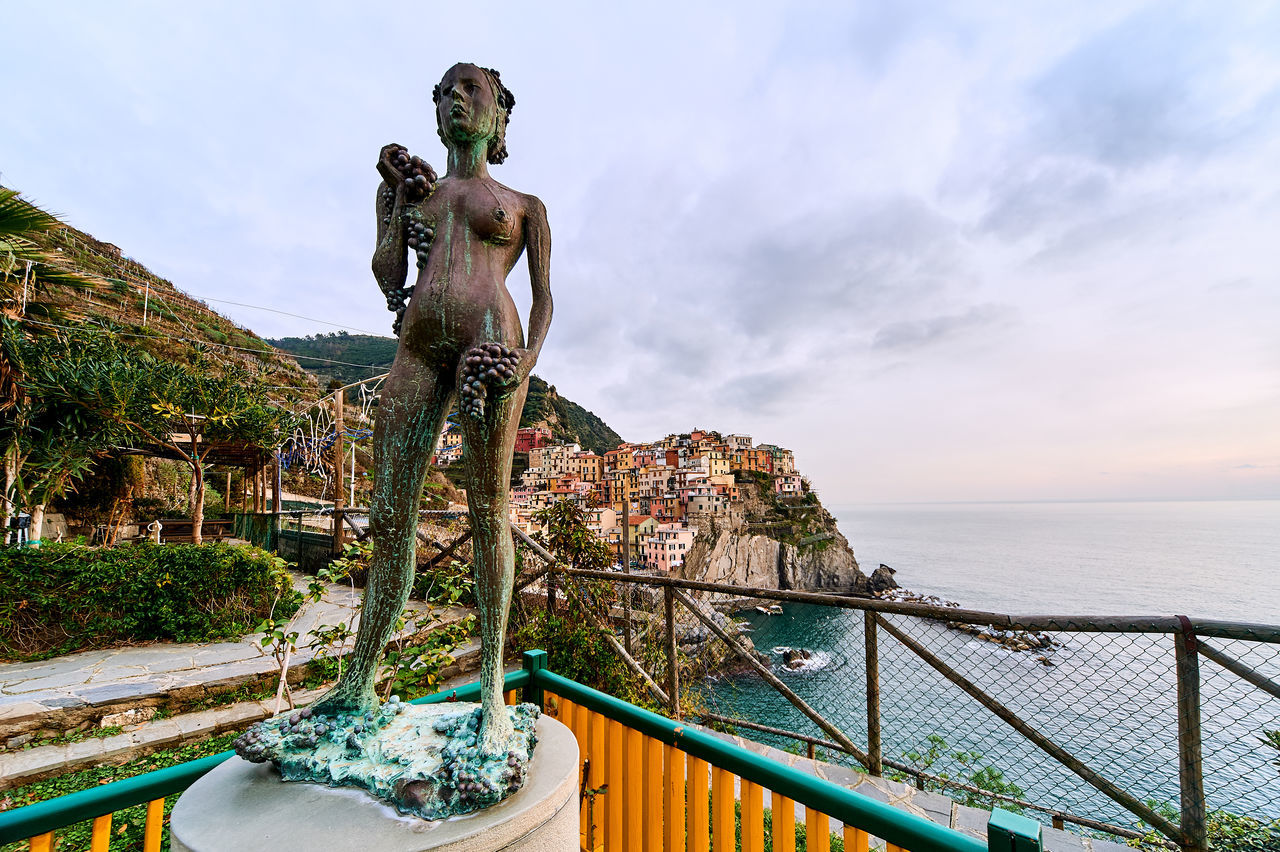 The Lady of the Grapes statue in Manarola. Manarola in the heart of the Cinque Terre, which means the five lands - part of the Italian Riviera. Ancient Architecture Architecture Beauty In Nature Cinque Terre Cloud - Sky Grapes Italian Riviera Italy La Spezia Landscape Liguria,Italy Manarola Mediterranean Sea Mountains Nature Old Outdoors Scenics Sculpture Statue Sunset The Lady Of The Grapes Town Travel Destinations Village