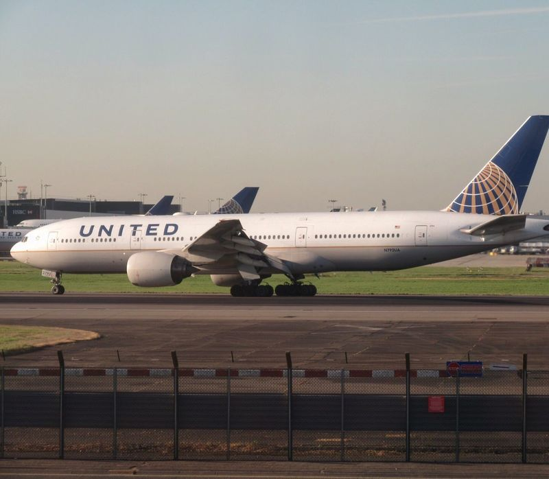 United Airlines Boeing 777 arriving from Washington. Airplane Air Vehicle Airport Runway Transportation Airport No People Day Aerospace Industry Outdoors Unitedairlines Clear Sky Boeing Heathrow Airport Airline Travel Aircraft Pilot Airportphotography Aviationphotography Sky United Kingdom Aviation LHR Flightview