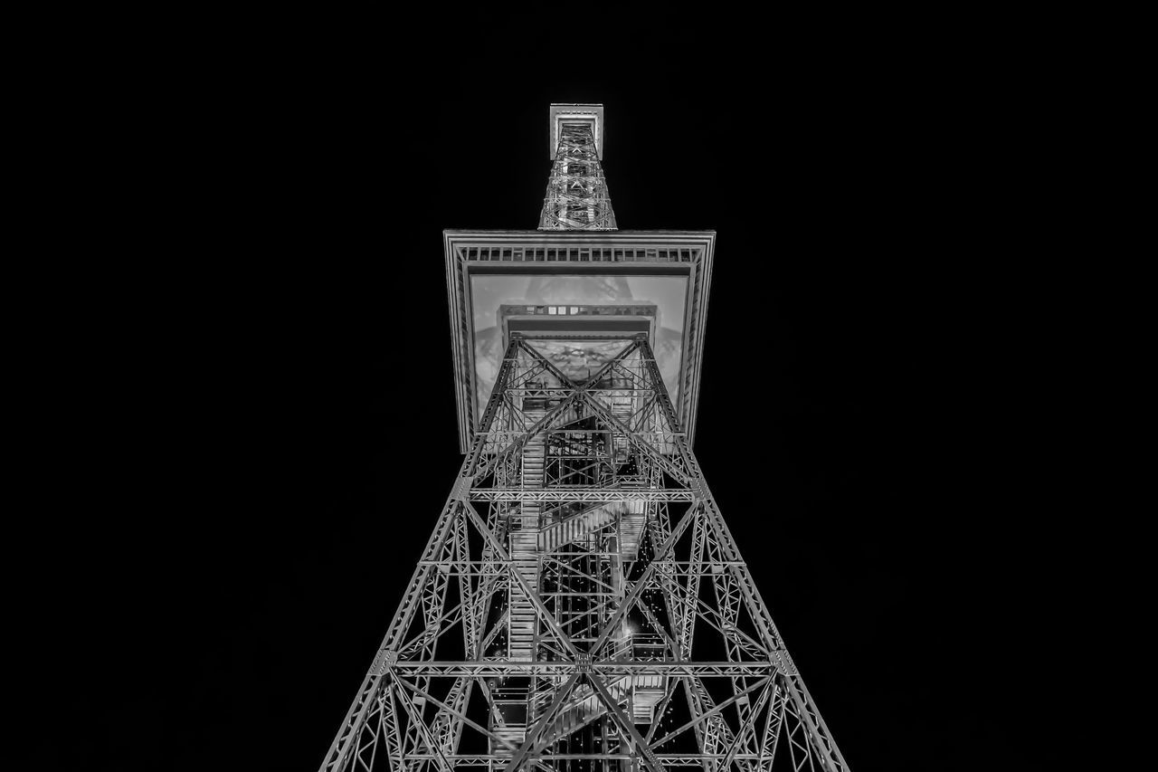 low angle view, night, architecture, clear sky, tower, built structure, no people, illuminated, outdoors