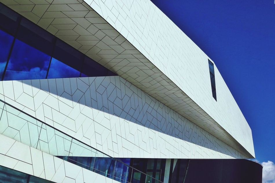 Architecture Low Angle View Built Structure Modern Building Exterior No People Day Outdoors Clear Sky Sky City Modern Building Modern Architecture Cloud - Sky Skyscraper Modern Architecture Low Angle View City Repeating Patterns Modern Archictecture