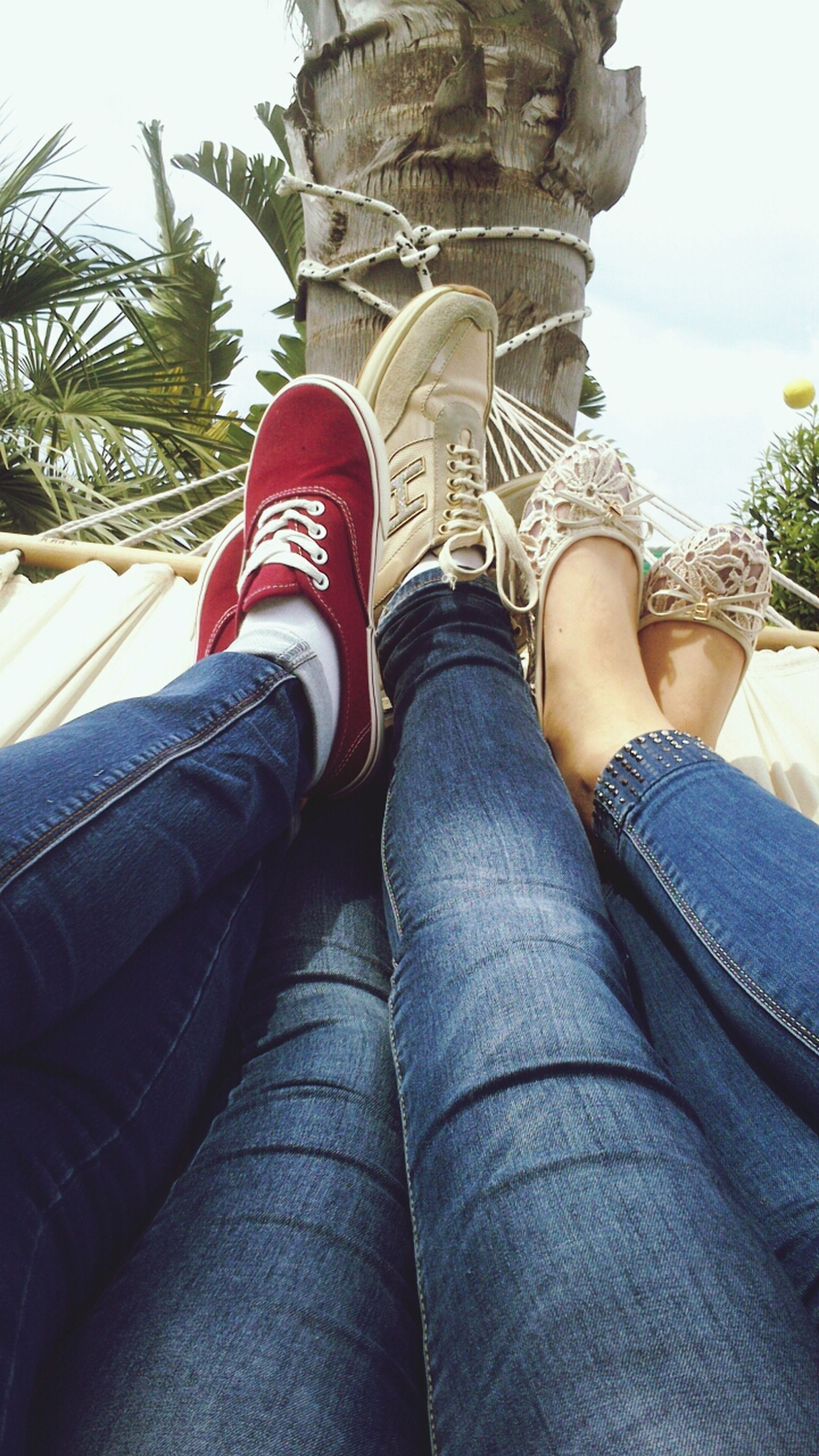 low section, person, personal perspective, lifestyles, shoe, jeans, human foot, leisure activity, sitting, relaxation, legs crossed at ankle, part of, footwear, resting, men, casual clothing