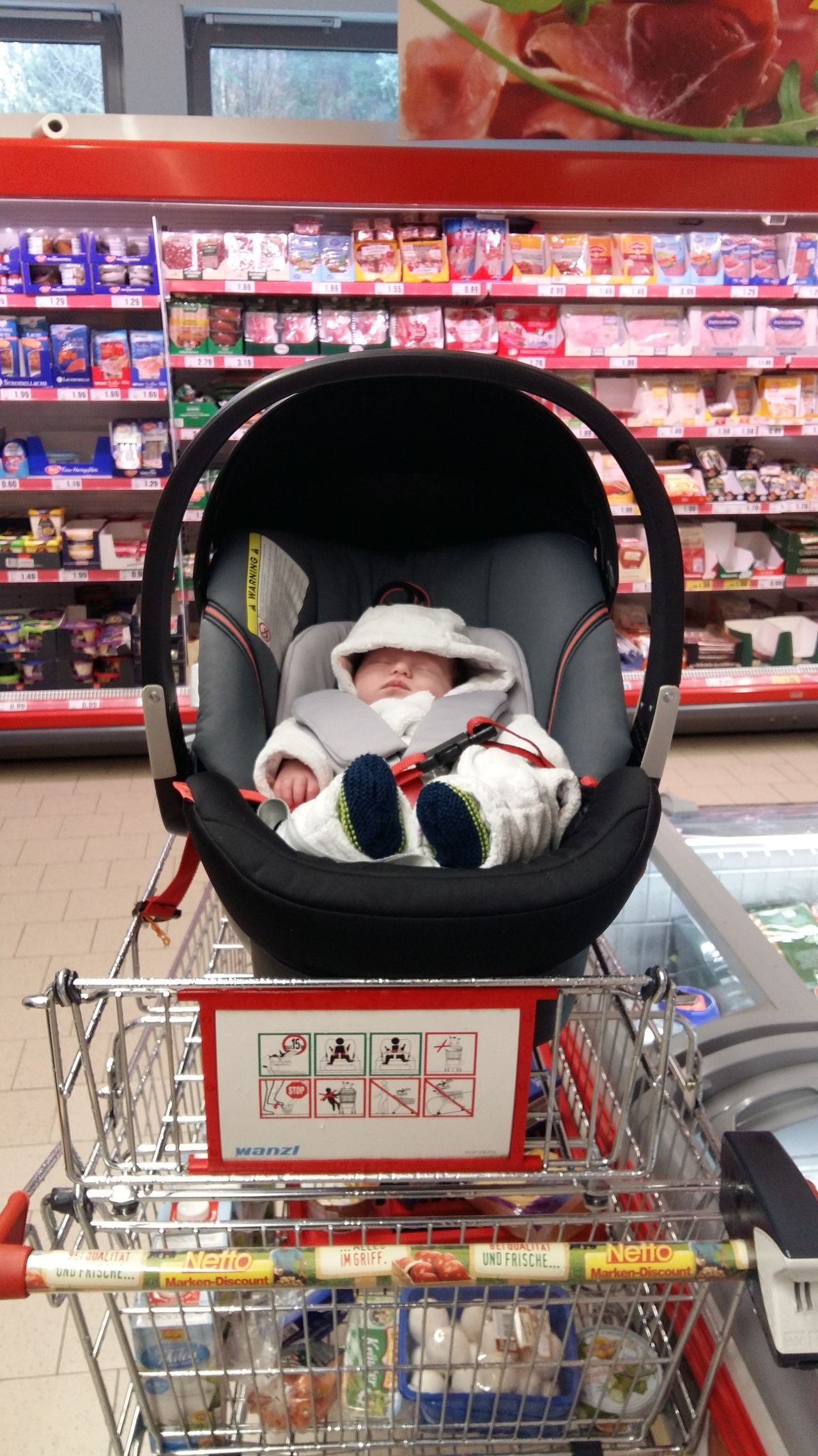 Going Shopping with your Baby Baby Childhood Close-up Day Discounter Einkaufen Mit Baby Einkaufswagen Front View German Supermarket Human Body Part Human Hand Indoors  Life With Baby Netto Discounter One Person People Retail  Shopping Shopping Cart Shopping Time Store Supermarket Take Your Baby Along