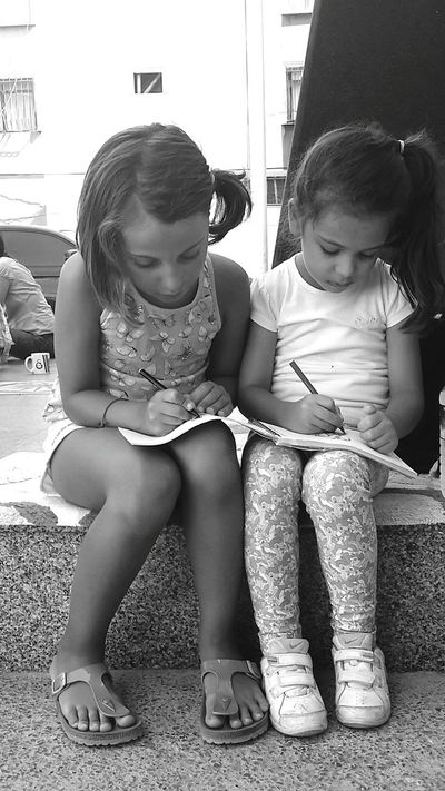 Blackandwhite Blaxkandwhite Blackandwhite Photography EyeEm Best Shots Togetherness Love Bonding Full Length Elementary Age Girls Lifestyles Childhood Leisure Activity Casual Clothing Sister Architecture Sibling Building Exterior Family Person Day Innocence Friendship Outdoors The Color Of School