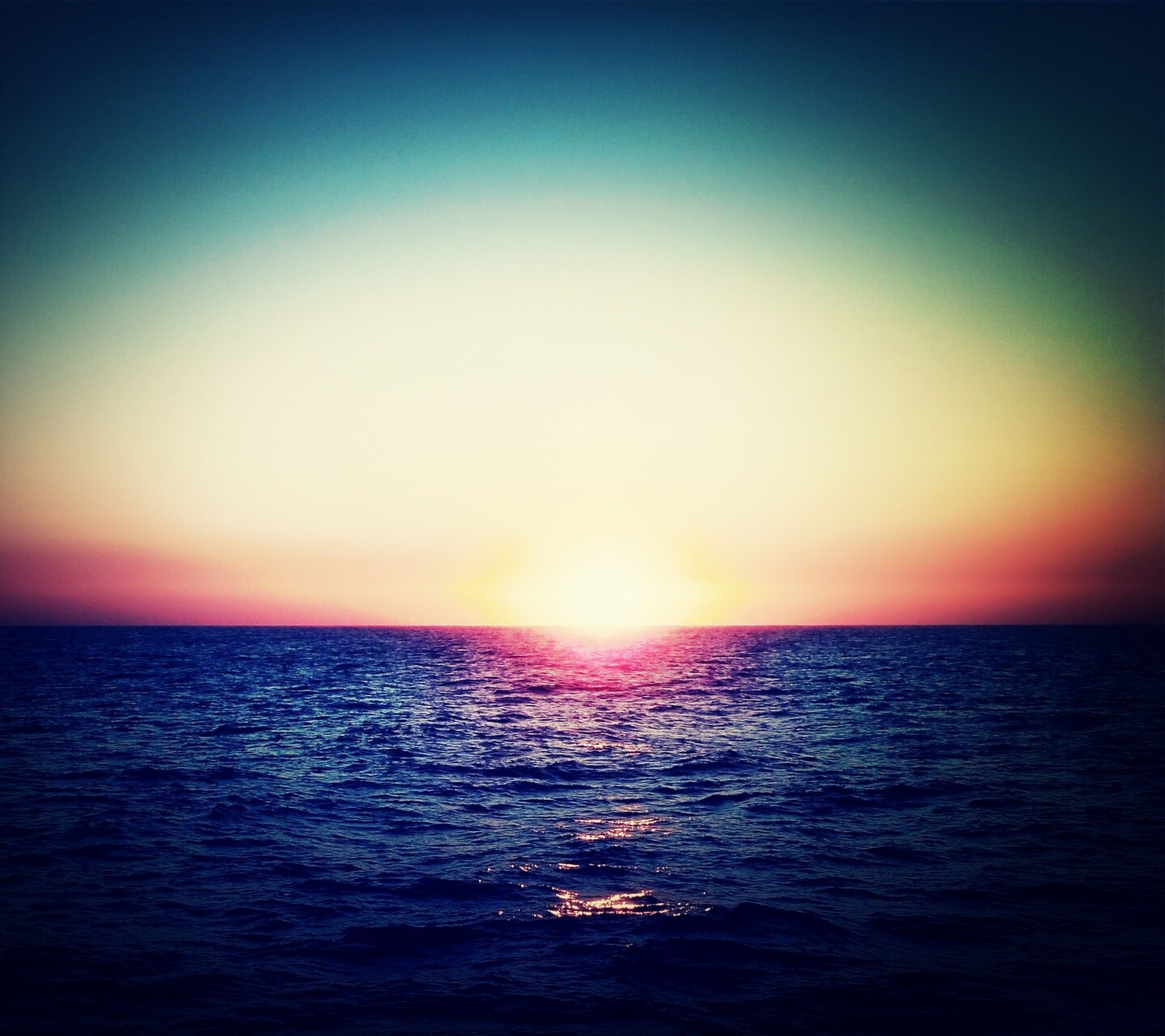 sea, horizon over water, water, sunset, sun, tranquil scene, scenics, tranquility, beauty in nature, waterfront, idyllic, clear sky, orange color, rippled, copy space, nature, seascape, reflection, sky, sunlight