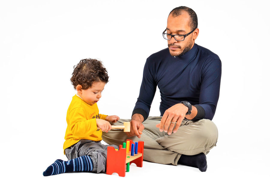 Father and son are playing together as part of the creative children therapy Adult Autism Child Childhood Creativity Didact Didactic Doctor  Family Fashion Males  Mediterranean  People Protecting Where We Play Terapist Terapy Therapy Togetherness Two People