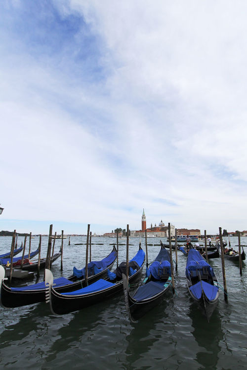 Venice stands for VEryNICE Blue Skies Canal Gondola Grand Canal Italy Picturesque Romantic City Tourist Destination Venice Water Waterway White Clouds
