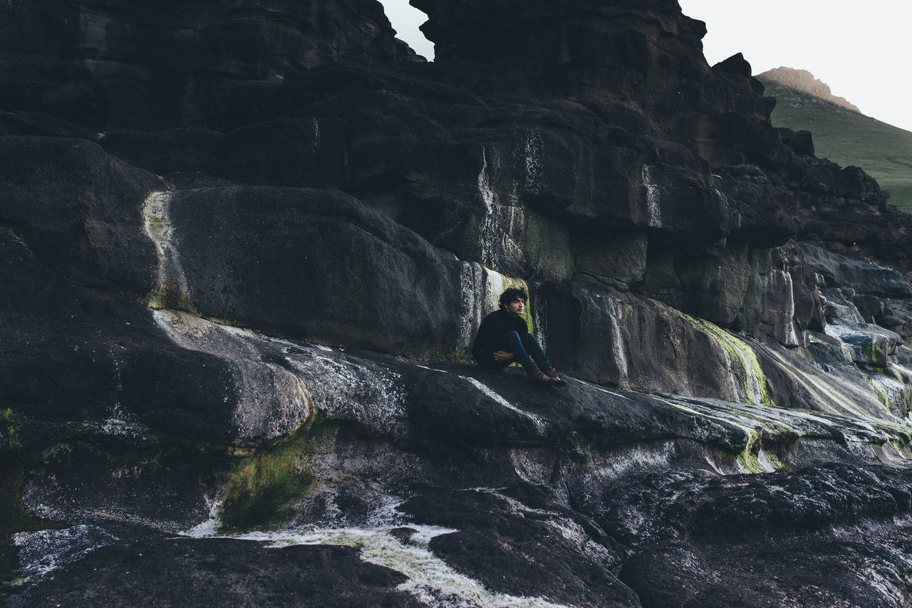 Adventure Beauty In Nature Cliff Day Extreme Sports Faroe Islands Motion Mountain Nature One Man Only One Person Outdoors People Power In Nature Rock - Object Rock Climbing Scenics Sky Water Waterfall