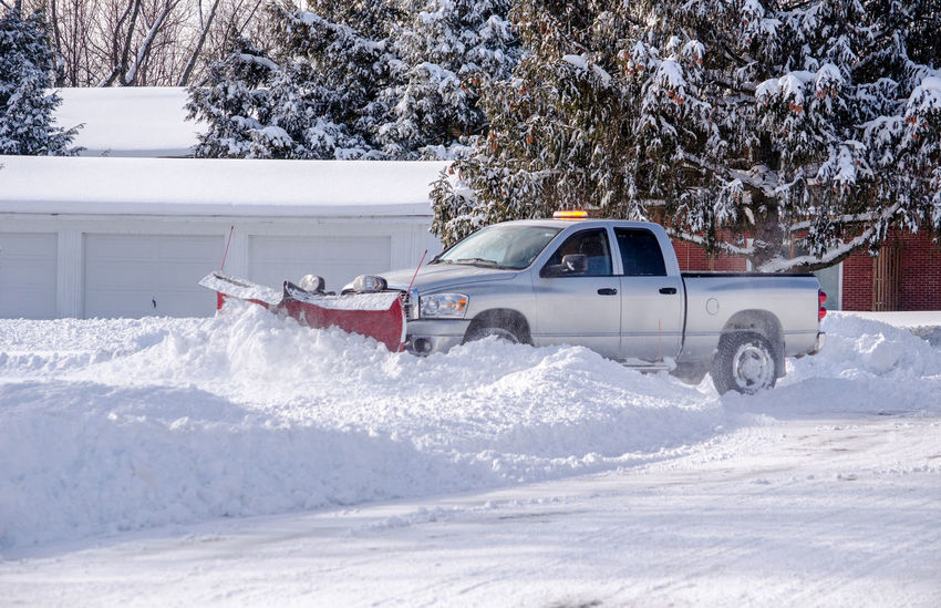worker moves snow with a heavy duty pick up truck and a powerful red snow blade, on a cold wintery day in Michgian USA Michigan Transportation USA Weather Work Worker Active Active Lifestyle  Cold Temperature Day Job Outdoors Plowing Snow Seasonal Seasonal Job Snow Snow Blade Snow Plow Tools Truck White Color Winter