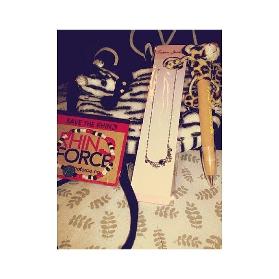 dad brought home some stuff(: Zebrapurse Savetherhinosbracelet Necklace Cheetahpen daddyshome imissedyou ·♡·
