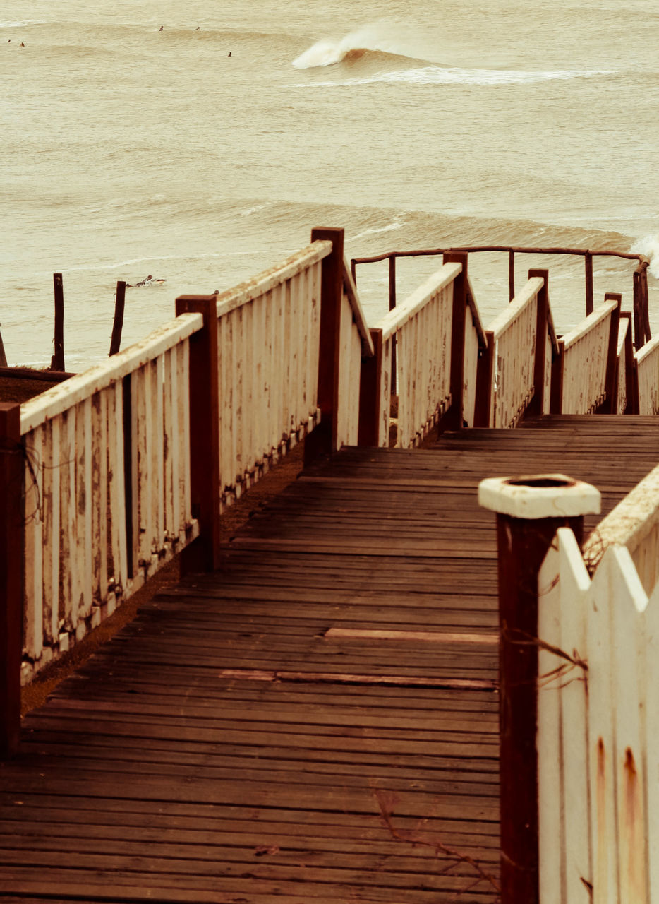 sea, beach, sand, water, shore, tranquility, railing, horizon over water, nature, tranquil scene, outdoors, wood - material, pier, day, wood paneling, scenics, no people, vacations, jetty, beauty in nature, sky