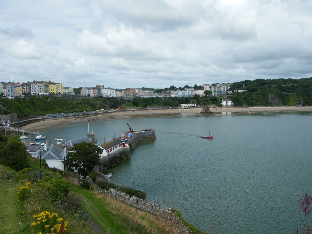 The Red Boat Building Exterior Built Structure City Cityscape Cloud - Sky Day High Angle View Nature Nautical Vessel. No People Outdoors Pembrokeshire Pembrokeshire Coast Pembrokeshire Coastal Path Sky Tenby Tenby Harbour Transportation Travel Destinations Tree Urban Skyline Water Waterfront