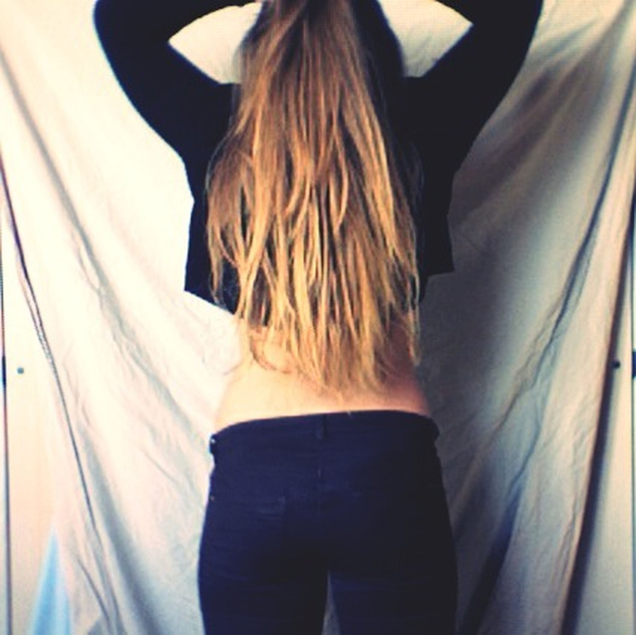 lifestyles, leisure activity, young adult, casual clothing, standing, long hair, young women, rear view, indoors, person, waist up, three quarter length, headshot, front view, brown hair, side view, day