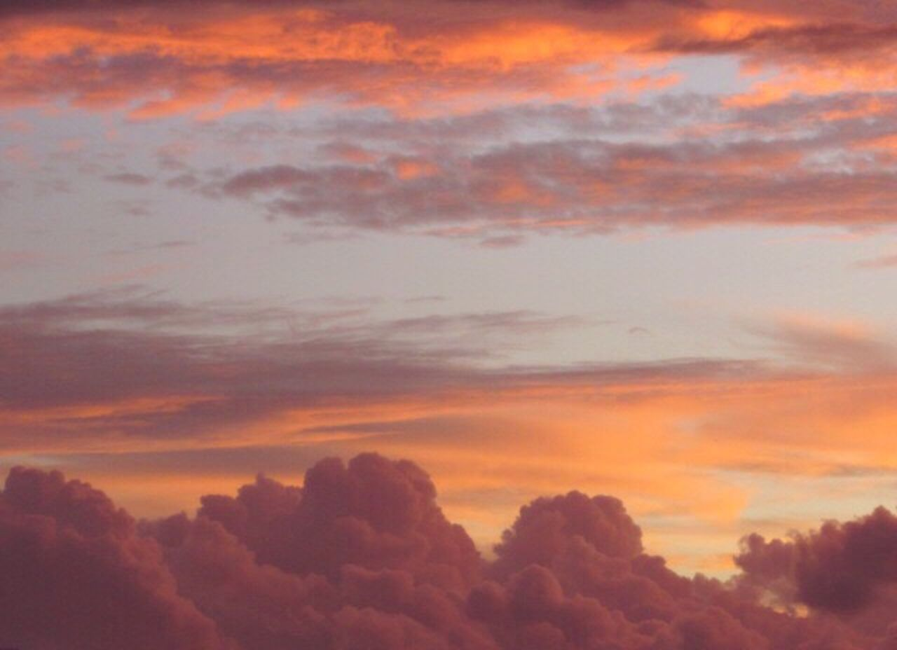 sunset, nature, beauty in nature, sky, cloud - sky, scenics, dramatic sky, tranquility, atmospheric mood, orange color, tranquil scene, sky only, backgrounds, no people, outdoors, low angle view, heaven, silhouette, day