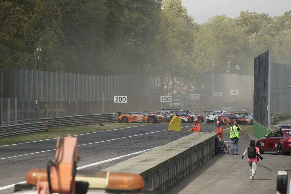 Accident Autodromo Chaos Day Dust Growth Leisure Activity Lifestyles Men Monza Nature One Person Outdoors People Race Real People Transportation Tree Yellow Flag