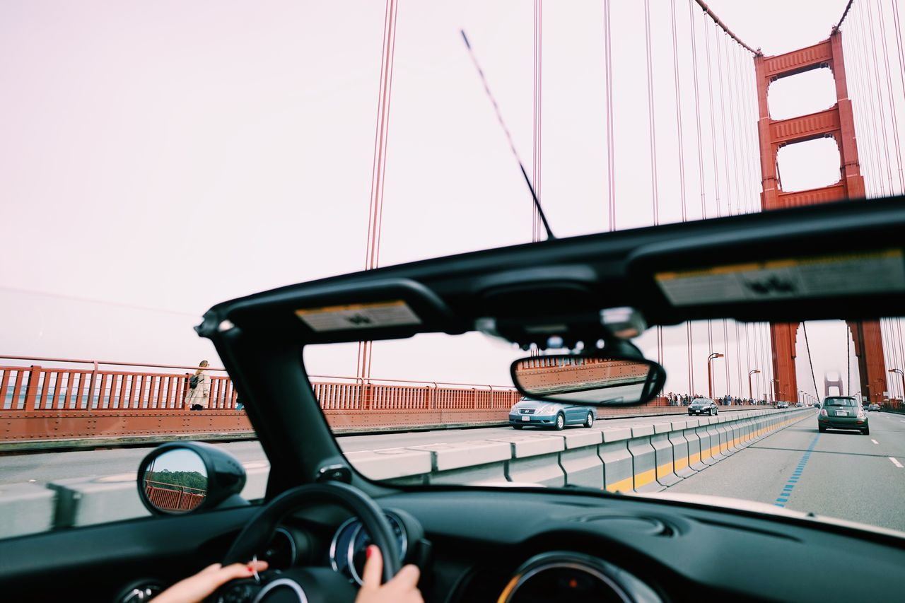 Golden Gate Bride Cabrio Convertible Mini Moment // Transportation Mode Of Transport Land Vehicle Car Steering Wheel Windshield Driving Day Road No People Outdoors Sky Close-up