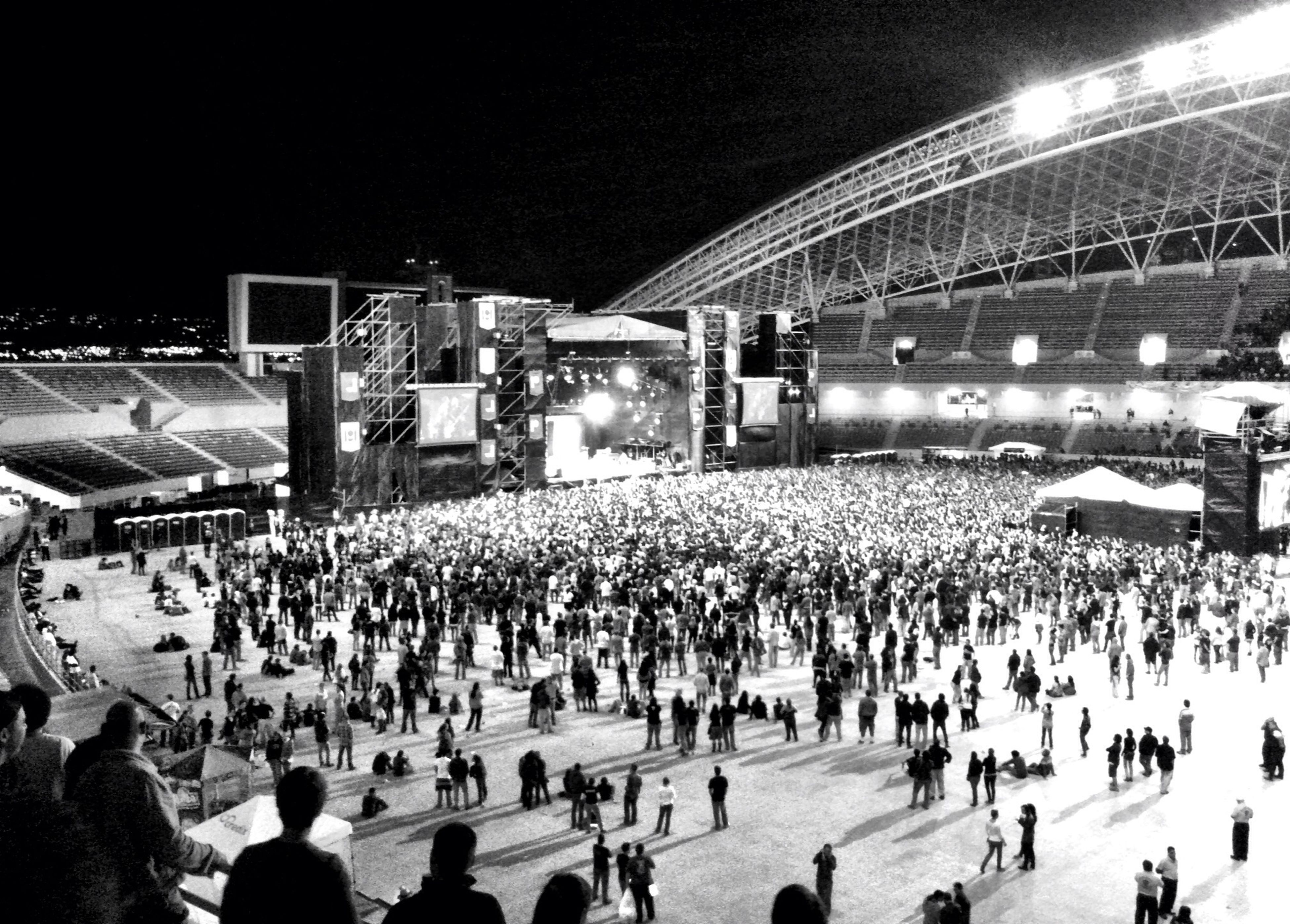 large group of people, crowd, illuminated, men, person, lifestyles, leisure activity, night, event, spectator, performance, arts culture and entertainment, enjoyment, music, stage - performance space, celebration, mixed age range, fun