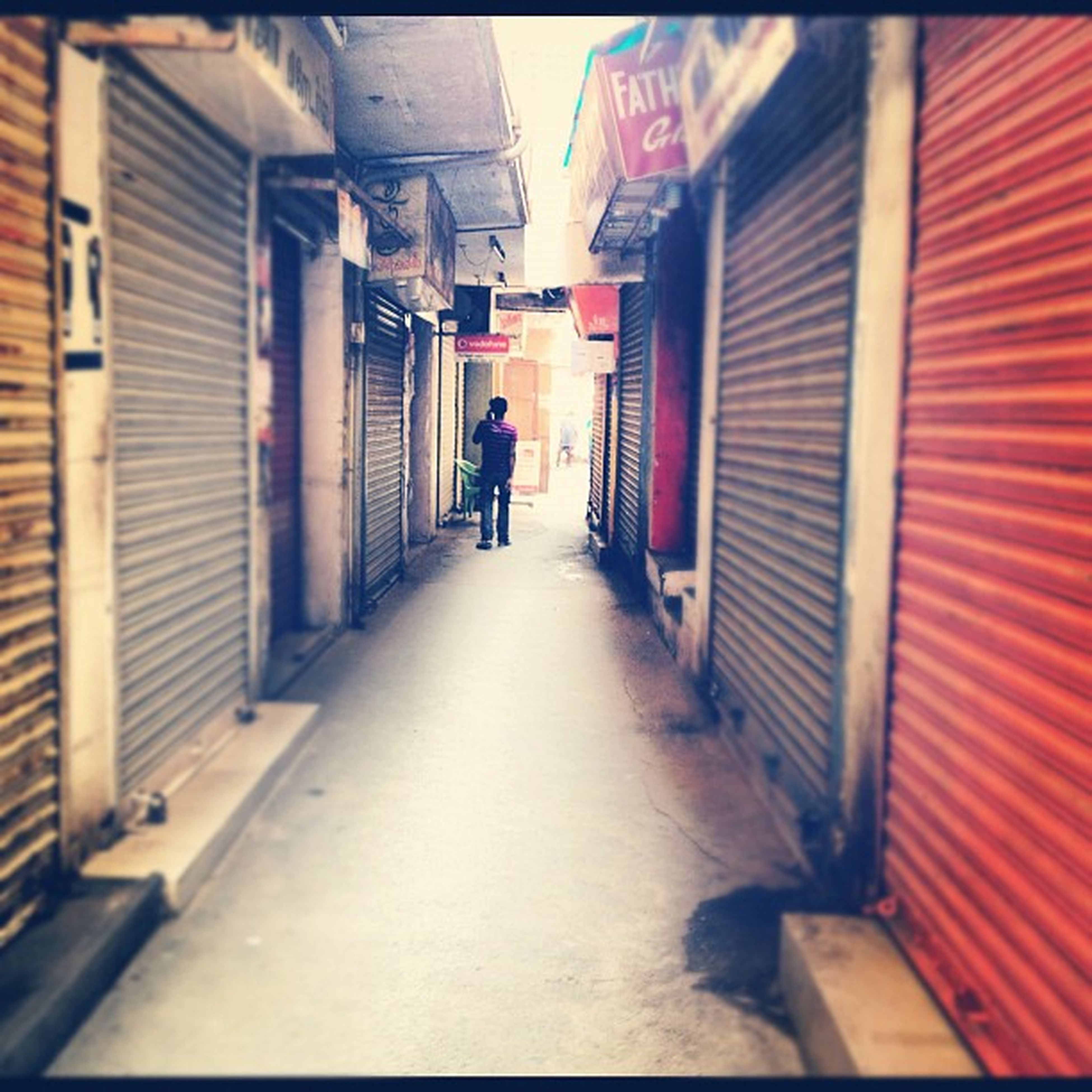 architecture, the way forward, built structure, building exterior, diminishing perspective, alley, walking, rear view, narrow, vanishing point, transfer print, men, full length, building, city, auto post production filter, street, corridor