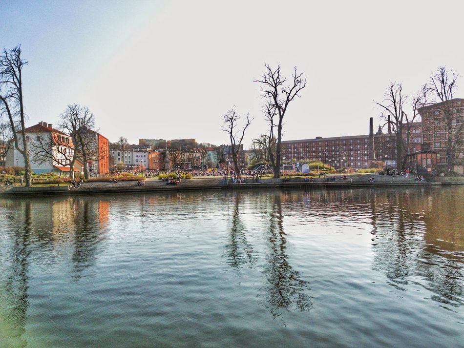 Poland Bydgoszcz Reflection Sky Water Outdoors Tree Building Exterior Architecture Day Rest City Landscape Spring Vacations Travel Real People People Large Group Of People Built Structure Polandarchitecture Architecture Travel Destinations Backgrounds Brna