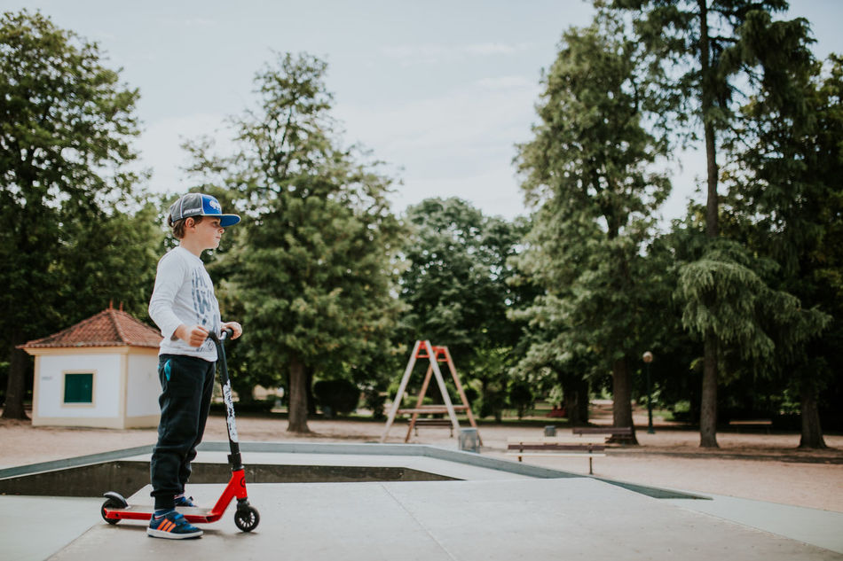 Boys Childhood Day Full Length Growth Hardhat  Headwear Helmet Kids Being Kids One Person Outdoors People Real People Skate Skateboarding Skatelife Skatepark Sports Helmet Tree