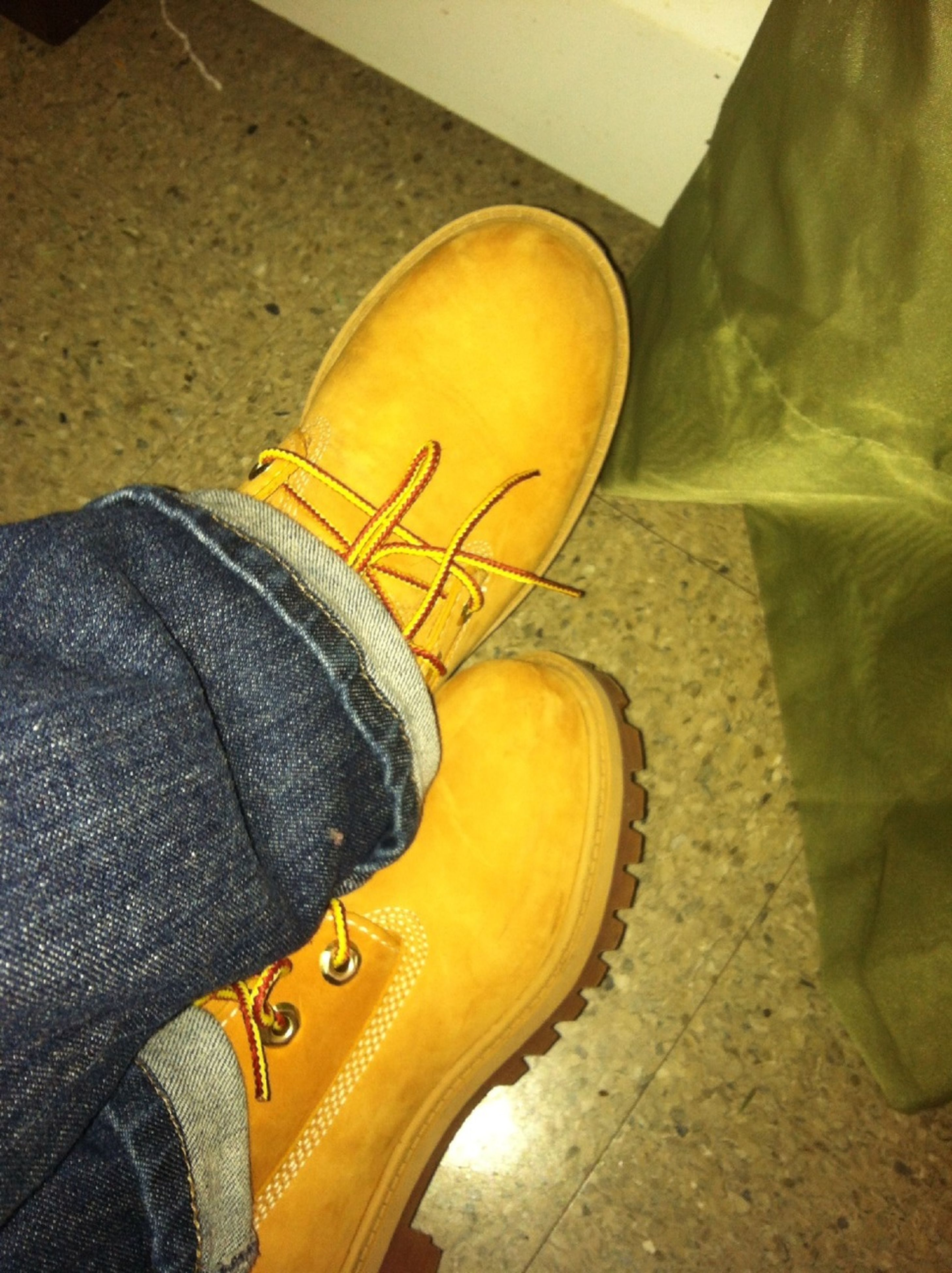 shoe, low section, person, yellow, footwear, personal perspective, indoors, jeans, high angle view, standing, men, lifestyles, pair, canvas shoe, close-up, unrecognizable person, human foot