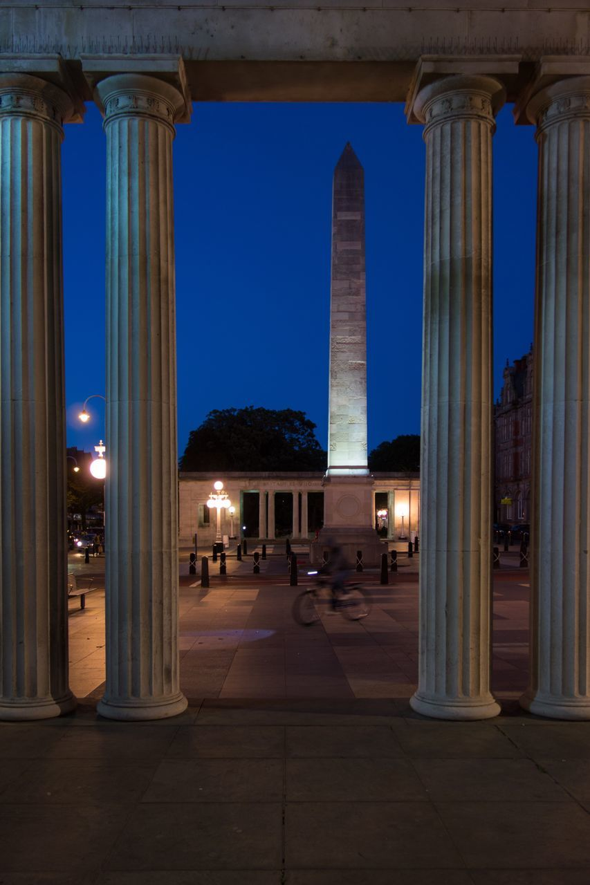 architecture, architectural column, illuminated, built structure, night, history, travel destinations, pillar, outdoors, no people, sky