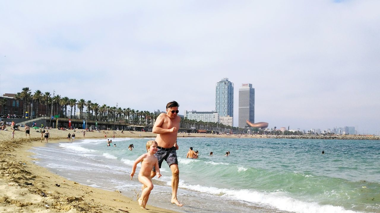 Beach Sand Sea Only Men One Man Only Sky Water Vacations One Person Shirtless Cloud - Sky Full Length Adults Only Outdoors Day One Young Man Only Motion Men Adult Leisure Activity Cataluña Spain Barcelona♡♥♡♥♡ Building Exterior Cityscape City Live For The Story