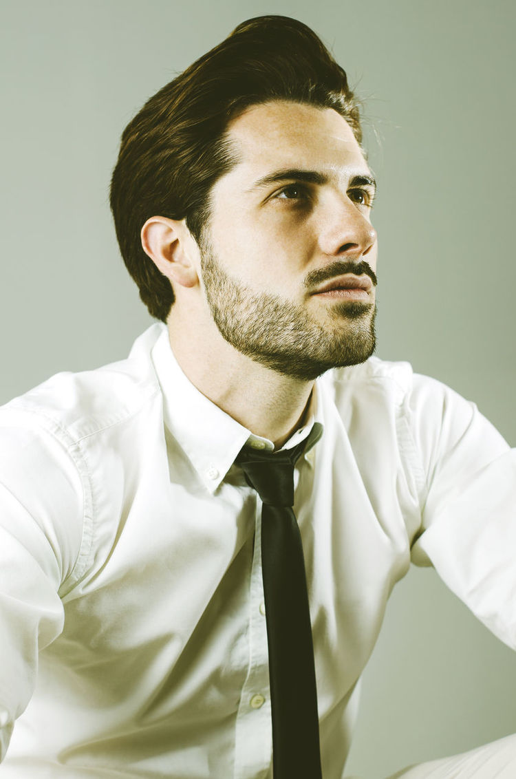 Black Tie Classic Portrait Confidence  Contemplation Elegance Everywhere Front View Hipster Hipster And Tie Hipster Style Hipster Tie Looking To The Future Portrait Retro Style Self Confidence Seriously Shirt And Tie Smart Studio Shot Young Male Young Man Young Man In Jeans