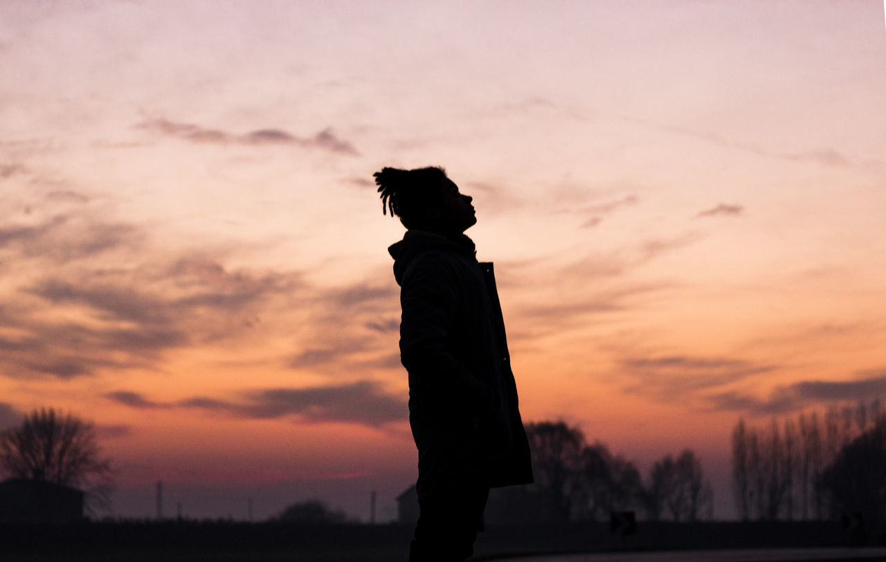 sunset, silhouette, orange color, sky, nature, one person, beauty in nature, cloud - sky, outdoors, scenics, standing, real people, people