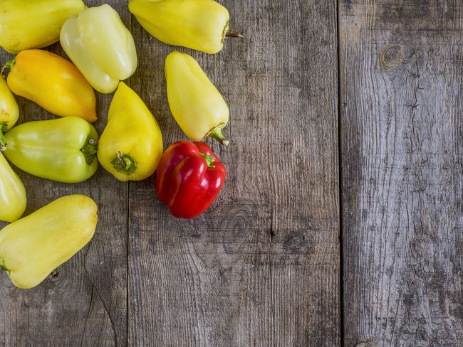 bell pepper on old wooden weathering table Assortment Bell Bell Pepper Food Food And Drink Freshness Green Group Of Objects Hot No People Pepper Red Red Bell Pepper Rosé Tomato Vegetable Vibrant Color Weathering Wood Wooden