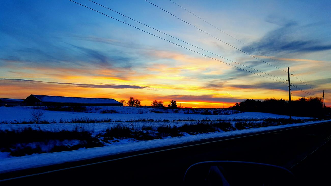 My favorite observed sunset of 2016.. Sunset Farm Silhouette Beauty On The Road Winterscapes Snowy Sunset