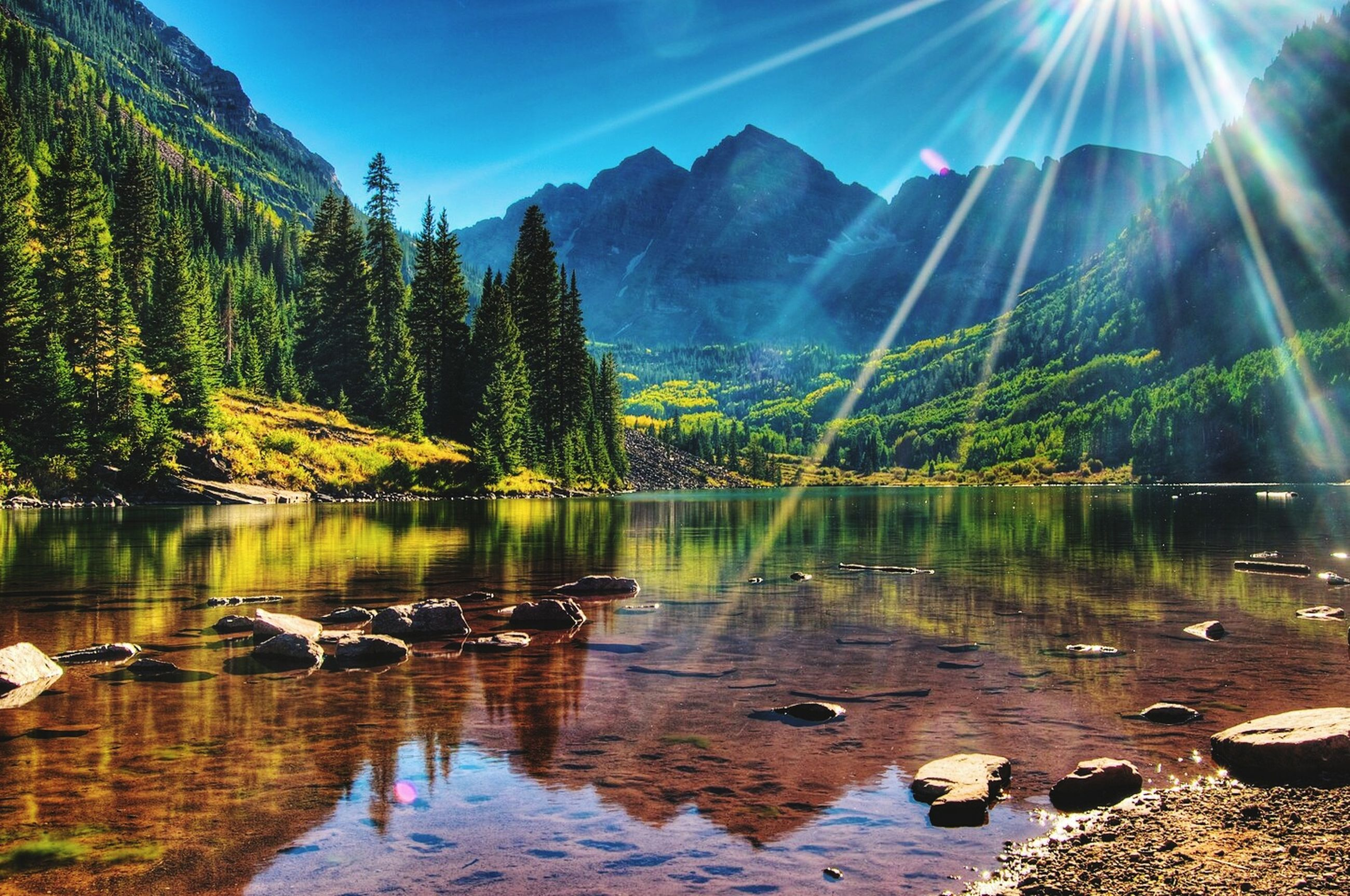sun, water, tranquil scene, tranquility, reflection, sunbeam, sunlight, scenics, beauty in nature, lake, lens flare, tree, mountain, nature, idyllic, sunny, sky, non-urban scene, landscape, bright