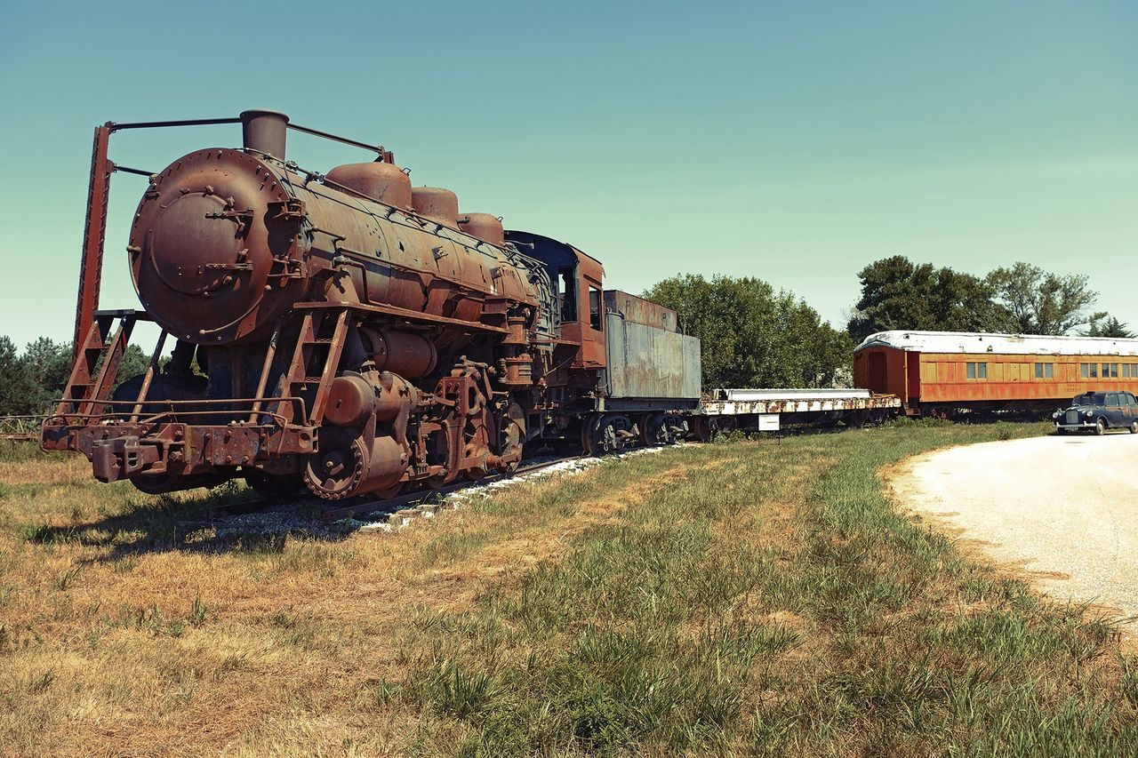 train - vehicle, transportation, mode of transport, rail transportation, railroad track, locomotive, day, steam train, abandoned, no people, freight transportation, outdoors, history, sunlight, clear sky