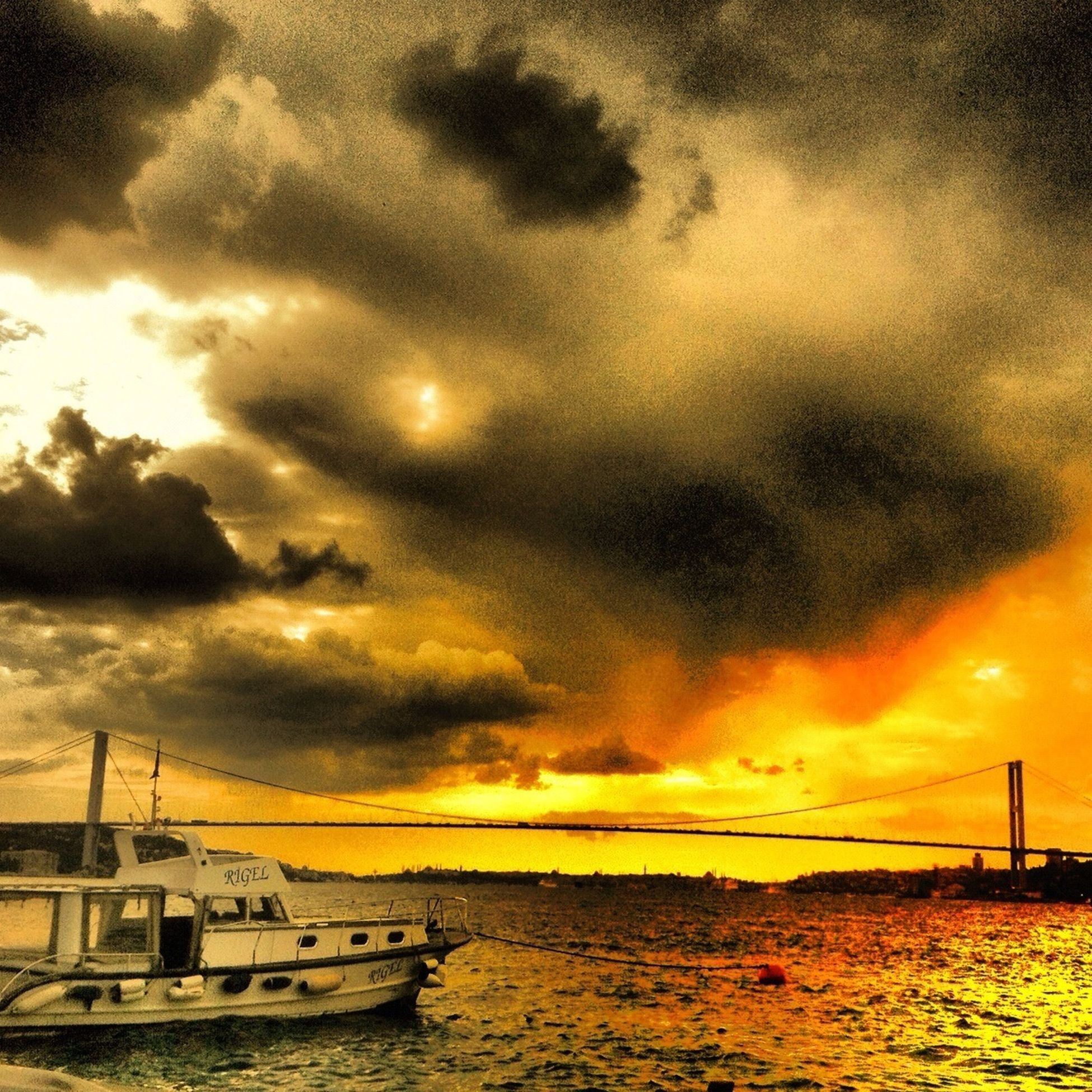sunset, sky, cloud - sky, sea, water, scenics, cloudy, beauty in nature, tranquility, tranquil scene, dramatic sky, orange color, nature, idyllic, cloud, weather, transportation, overcast, waterfront, horizon over water