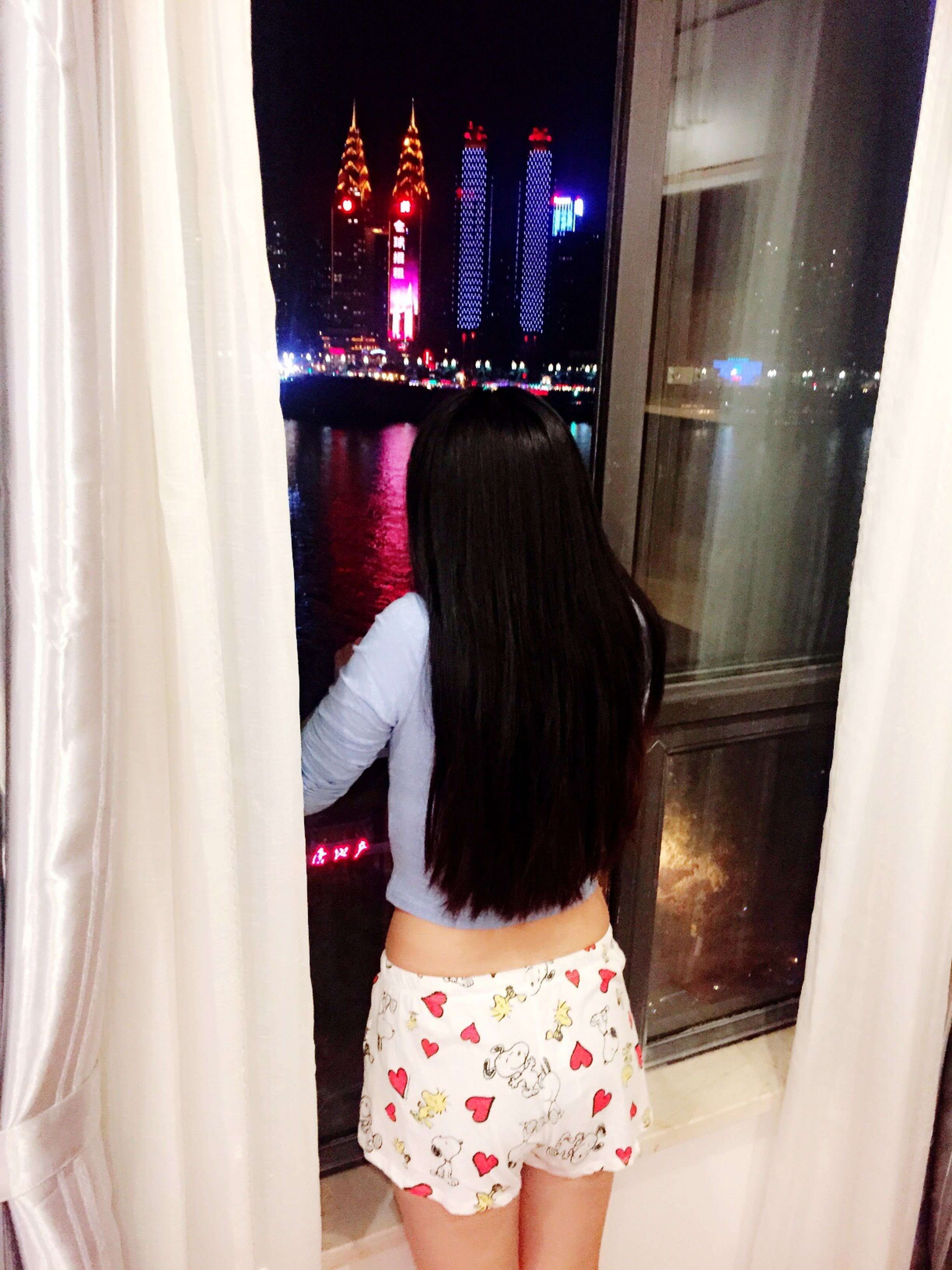 rear view, indoors, person, lifestyles, architecture, standing, built structure, leisure activity, full length, casual clothing, young women, long hair, three quarter length, sitting, curtain, waist up, side view, window