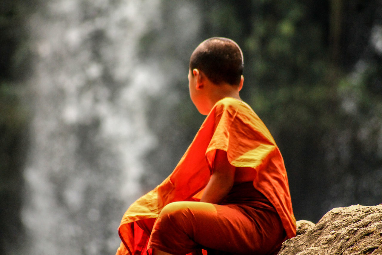 Religion Spirituality Place Of Worship Cultures Rear View Day People Young Monk Buddhist Monks Buddhism Peace Calmness Ponder State Of Mind  Siem Reap, Cambodia Minimalism People Watching Saffron Red Outdoors Kulen Mountain Cambodia Solitude Human Interaction Emotions