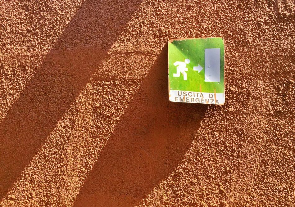 Warning Sign Communication Danger No People Day Sunlight Outdoors Nature Close-up Emergency Exit Plate Icon Wall Rough Sunny Shadows