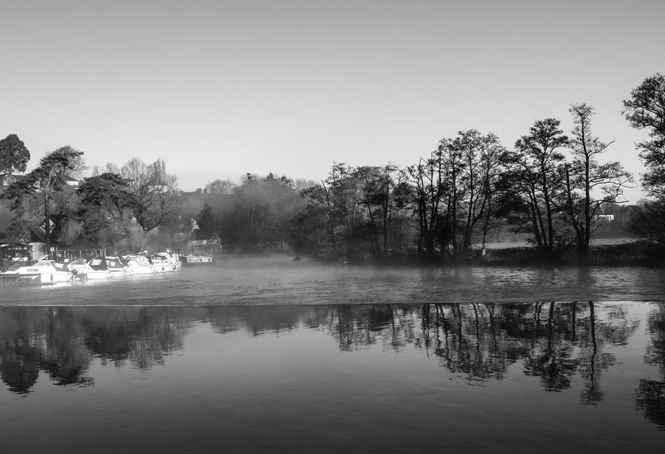 Weir on the River Avon at Saltford, Somerset. Bare Tree Blackandwhite Boats Cold Cold Temperature Majestic Misty Morning Monochrome Outdoors Reflection River Riverbank Scenics Standing Water Still Tranquil Scene Tranquility Tree Water Waterfront Weather Winter