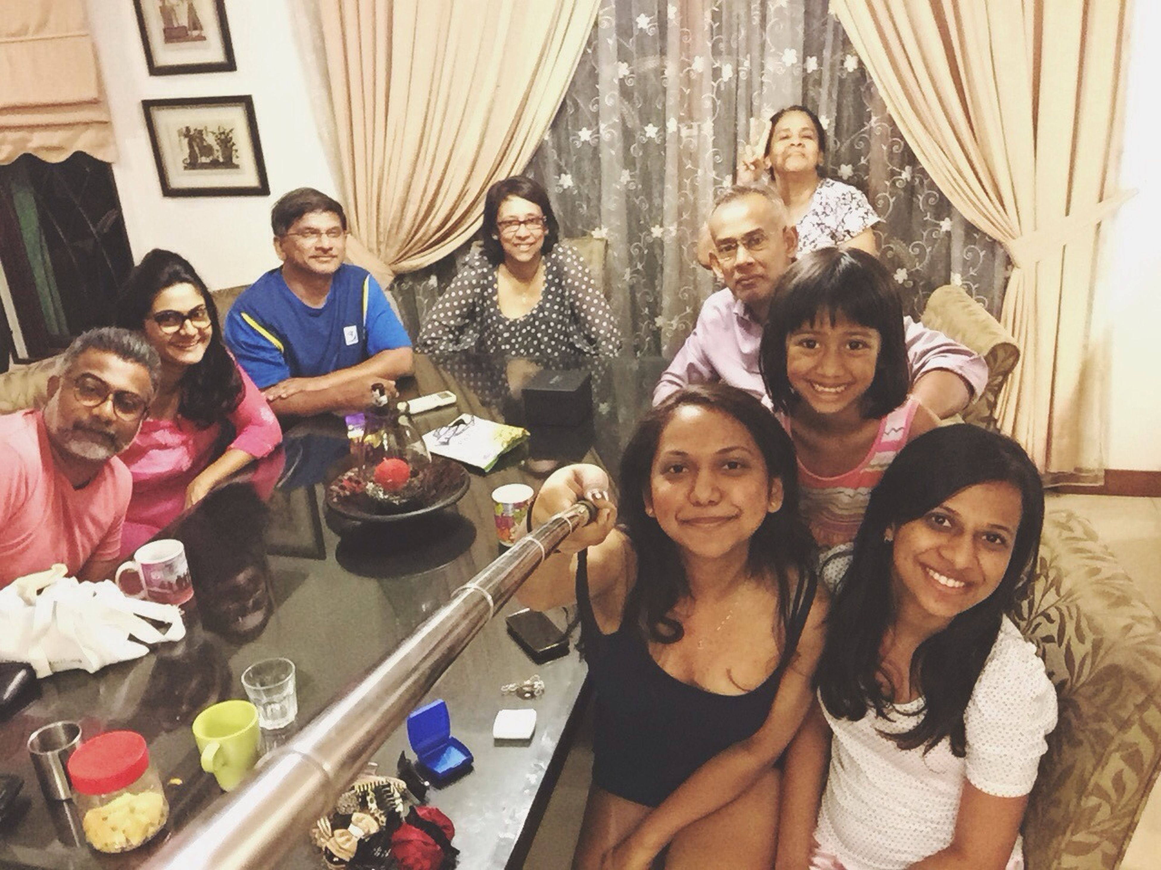 indoors, togetherness, lifestyles, portrait, looking at camera, happiness, leisure activity, person, smiling, front view, bonding, young adult, casual clothing, friendship, fun, celebration, enjoyment, young women