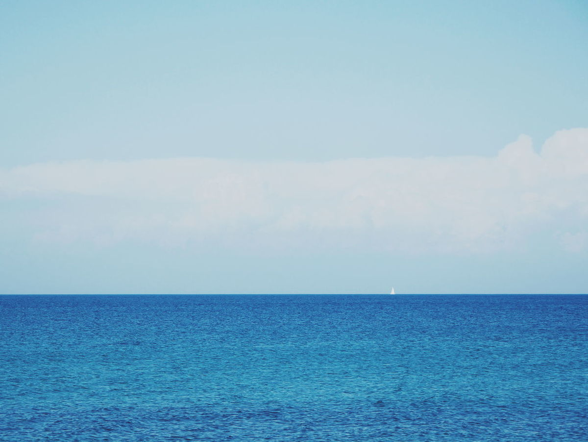 Sea Horizon Over Water Blue Scenics Tranquility Water Tranquil Scene Nature Beauty In Nature Sky Outdoors No People Day Clear Sky Vacations Pastel Colored Sailing Ship Sailing Sailing Boat