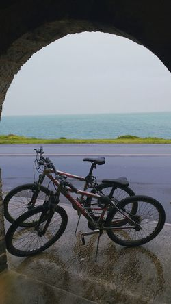 Rainy bike ride in Bermuda Bermuda Rainy Days Sea Bicycle Beach Water Horizon Over Water Transportation Tranquility Outdoors Travel Destinations No People