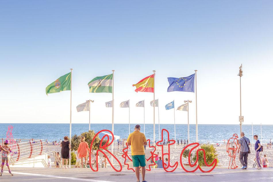 Beach tourism in Spain. Rota, Cadiz. Beaches of andalucia Beach Cadiz City Family Mediterranean  Men Ocean Ocean View Paradise People Promenade Relaxation Resort Rota Sand Sea SPAIN Summer Sunset Tourism Travel Destinations Vacations Walk Water Woman