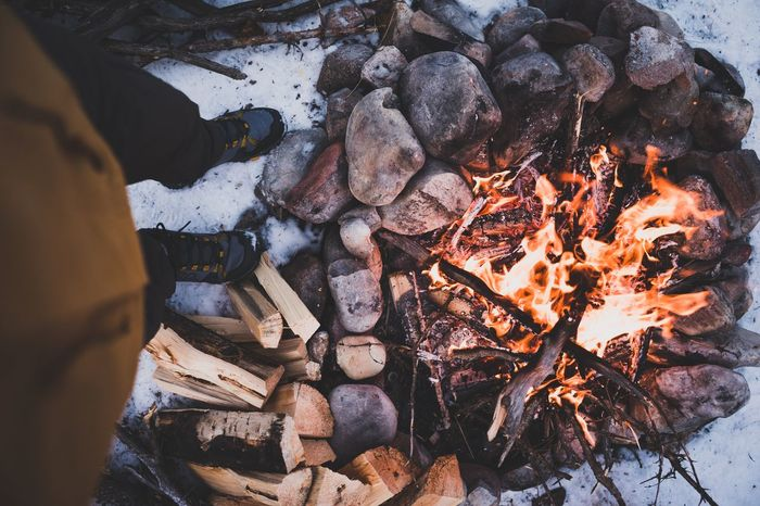 Outdoor life at the camp fire Roam Warm Snow Winter Stones Lifestyle Outside Fire Place Bonfire Camping Fire Bird View Top Fire From The Top Live Authentic Outdoors Camping Burning Heat - Temperature Flame Log Outdoors High Angle View Day No People Bonfire Nature