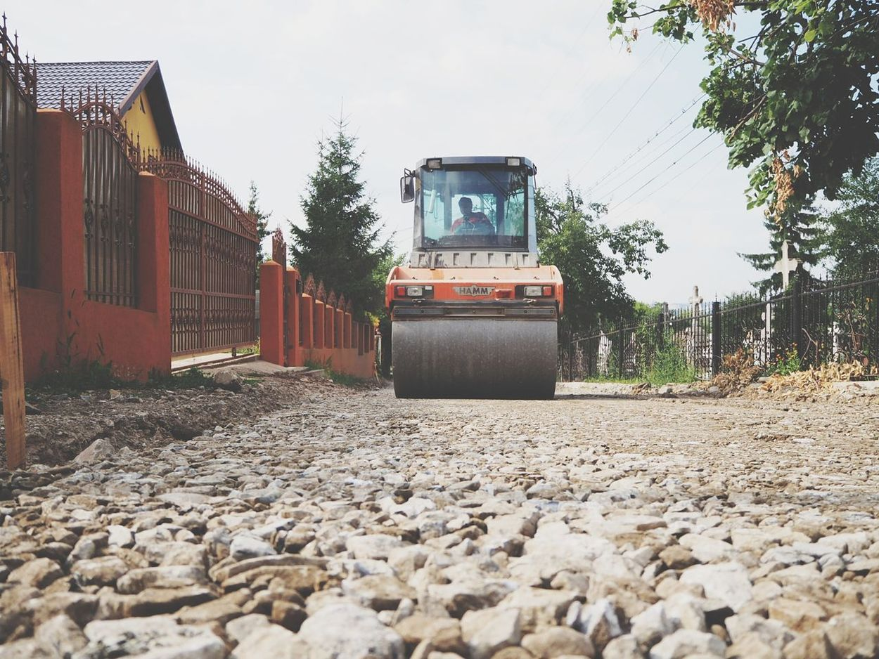 Gravel Road Compactor Compactor Plate Heavy Equipment Heavy Machinery Working Outdoors Rural Scene Road Road Works EyeEmNewHere Land Construction Machinery Construction Site Investing In Quality Of Life