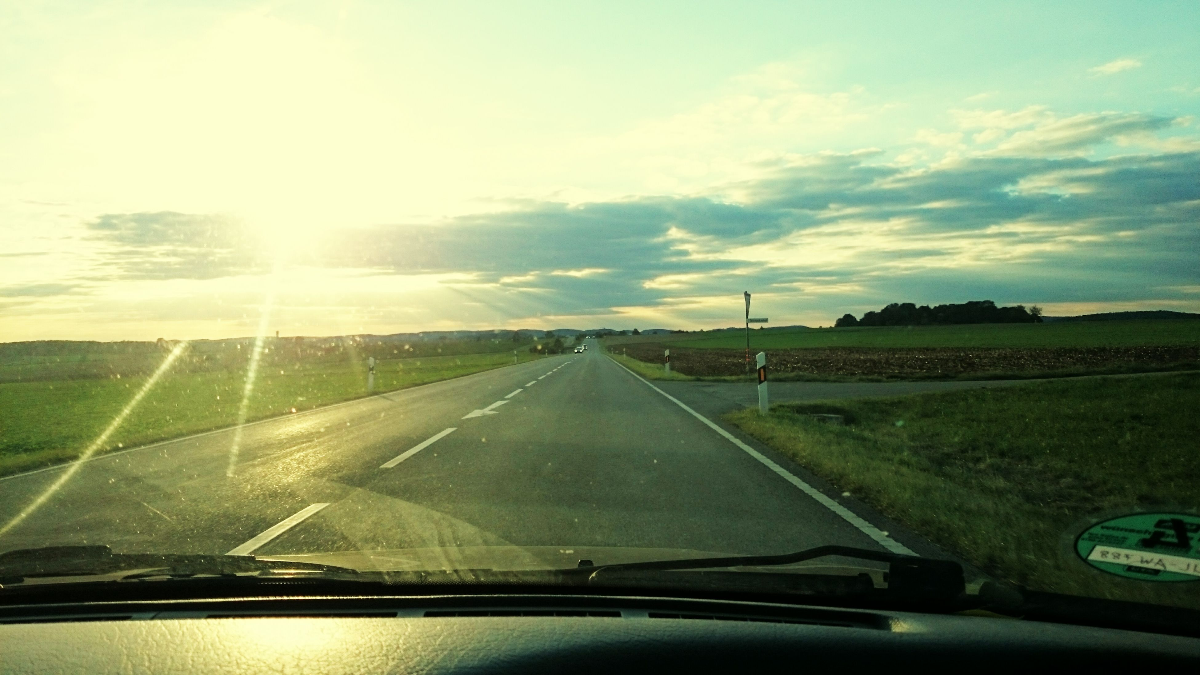 transportation, car, mode of transport, road, land vehicle, windshield, vehicle interior, the way forward, glass - material, diminishing perspective, road marking, car interior, sky, transparent, vanishing point, car point of view, travel, on the move, country road, cloud - sky