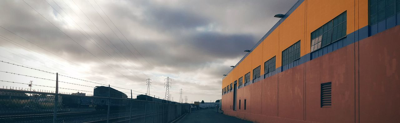 Architecture Built Structure City Cloud - Sky Cloudy Contrast Diminishing Perspective Industrial Orange Color Road Sky Train Yard Urban