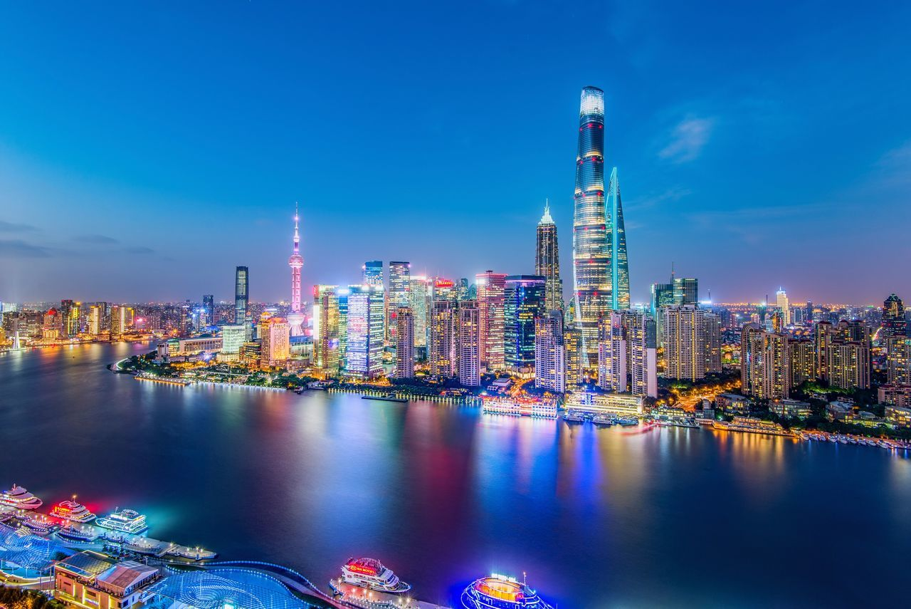 Skyscraper City Architecture Illuminated Building Exterior Built Structure Tower Urban Skyline Water Waterfront Modern Cityscape Night Outdoors Sky No People