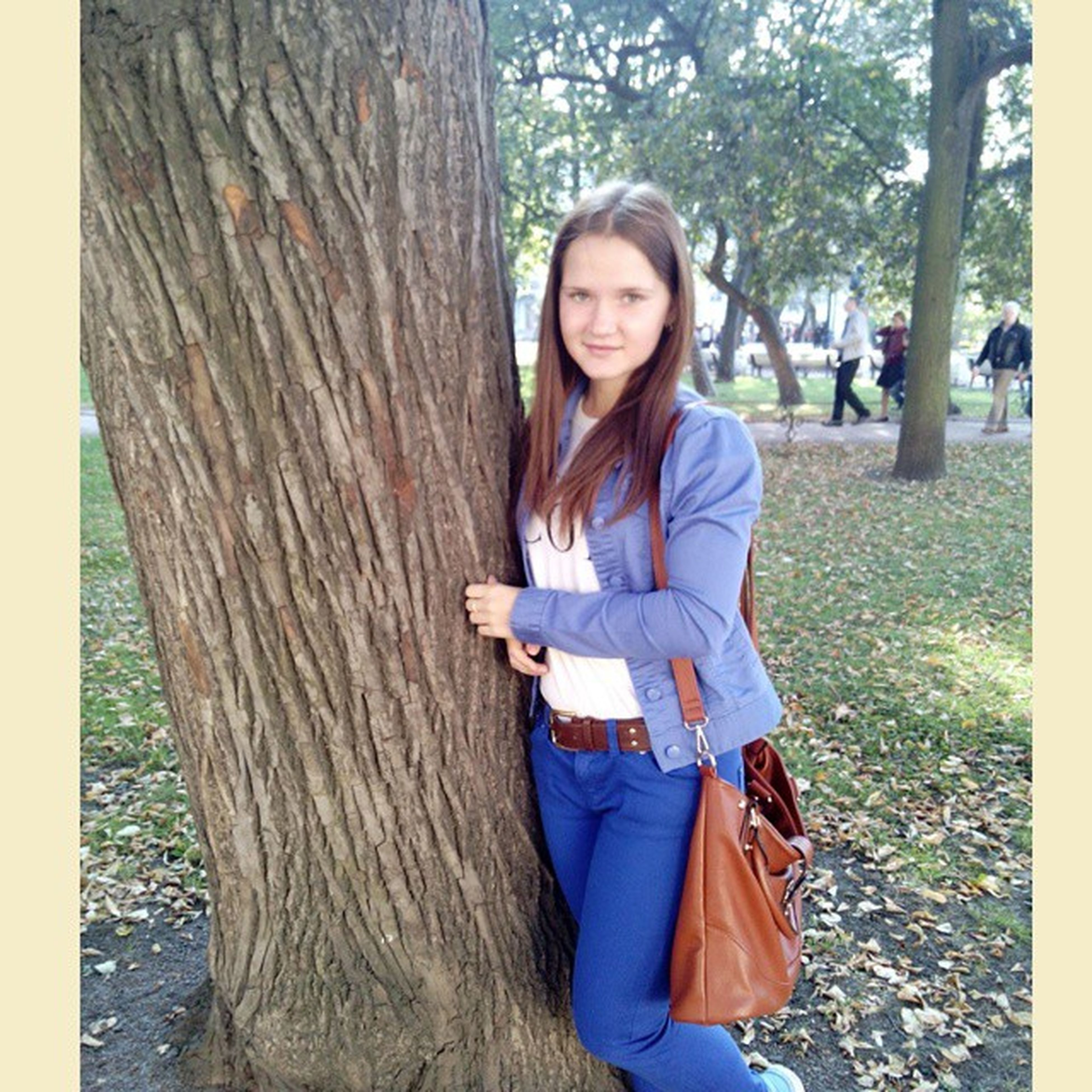 person, looking at camera, portrait, casual clothing, lifestyles, front view, smiling, tree, leisure activity, happiness, young adult, young women, park - man made space, long hair, standing, girls, childhood