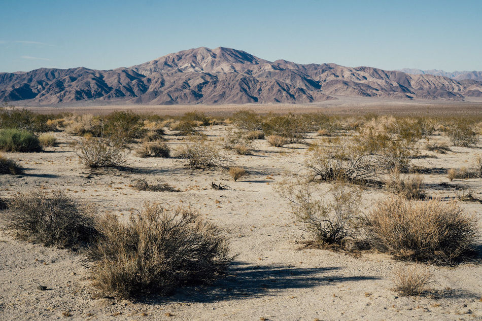 Arid Climate Barren Beauty In Nature Clear Sky Day Desert Geology Landscape Mountain Nature No People Non-urban Scene Outdoors Physical Geography Scenics Sky Sunlight Tranquil Scene Tranquility